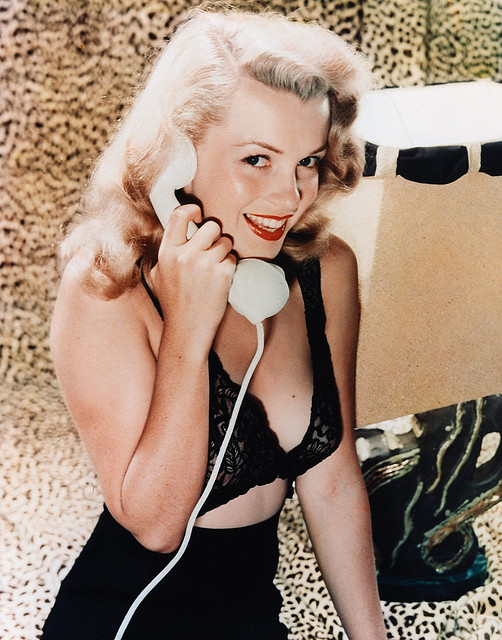 A young Marilyn Monroe pin up in a blace lace bra