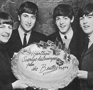 1960s the Beatles with a huge cake