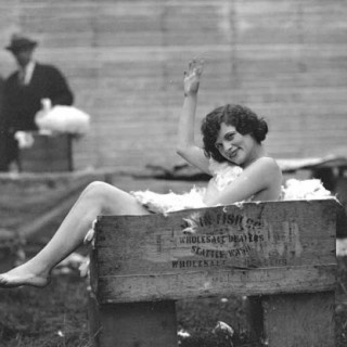 Naked girl a box of rabbit fur, 1920s