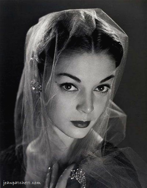 Jean Patchett in a veil photographed by Philippe Halsman