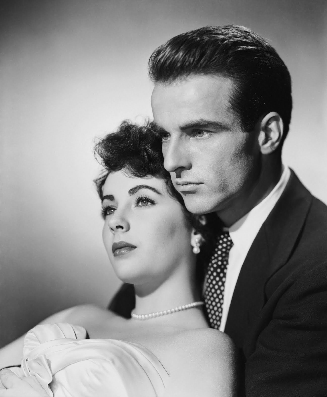 Elizabeth Taylor and Montgomery Clift looking vacant