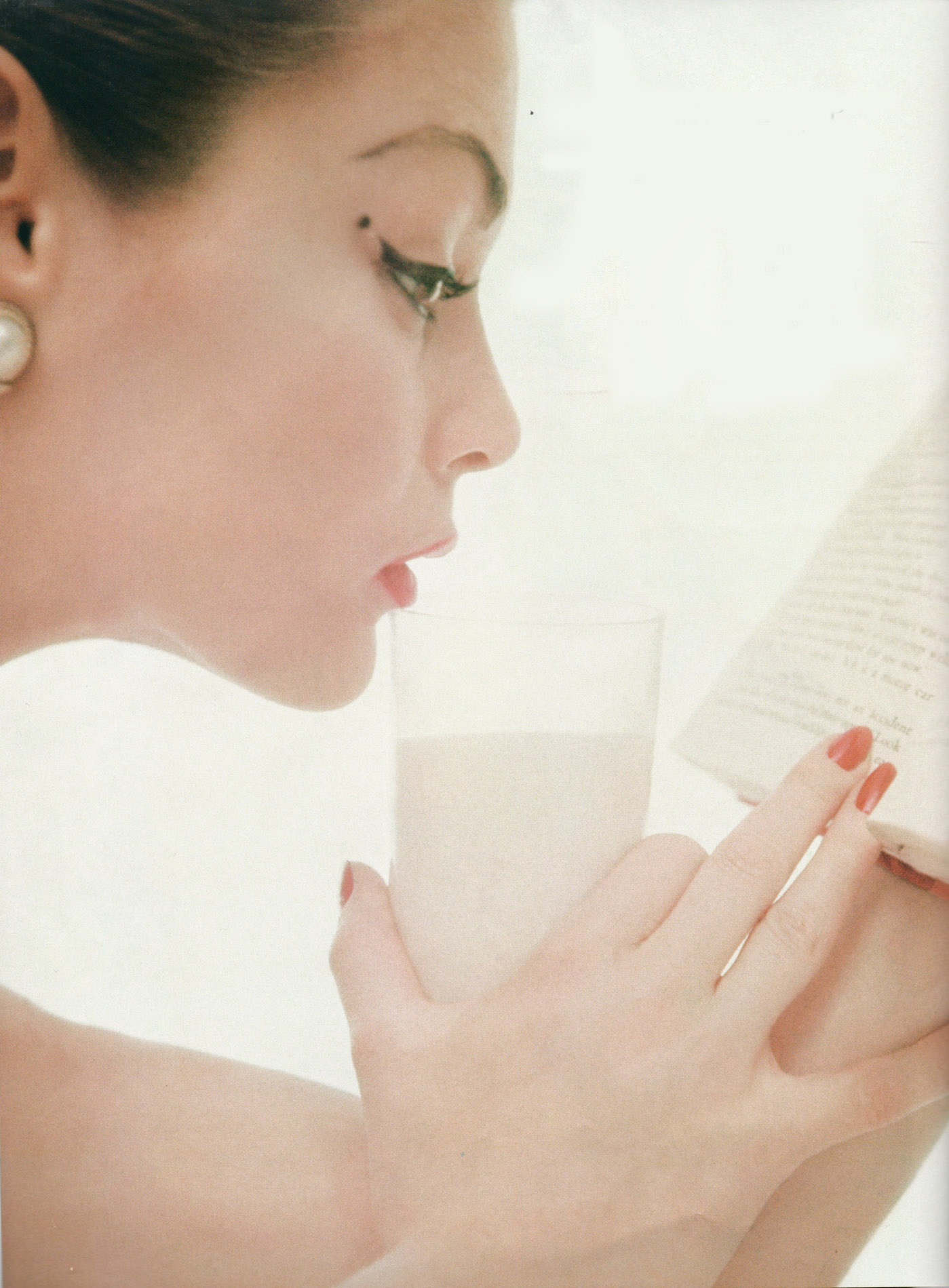 Jean Patchett drinking a glass of milk