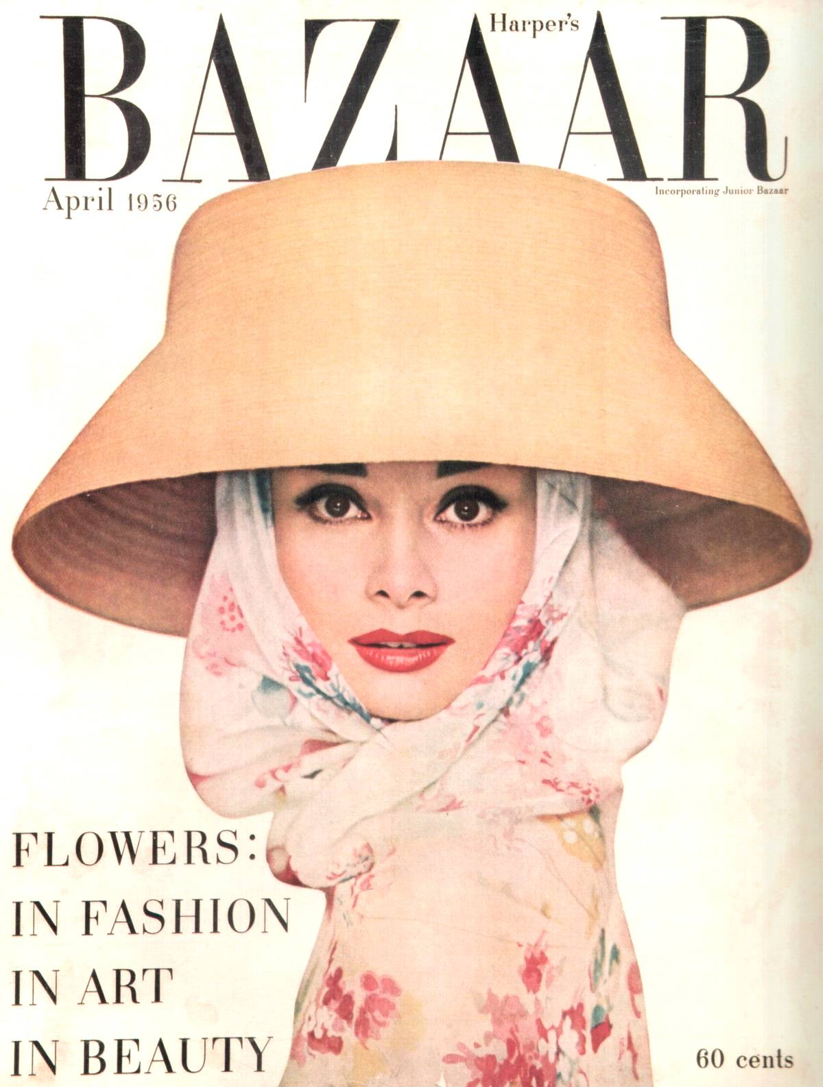 Audrey Hepburn (with big lips) covering 1950s Harpers Bazaar