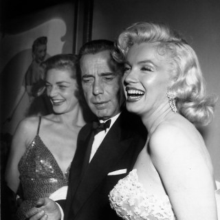 Marilyn having a laugh with Bogie and Bacall