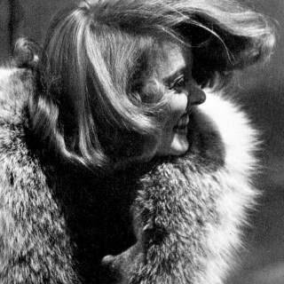 Bette Davis, windswept and smiling