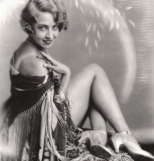 A Ziegfeld Girl showing us her tanlines